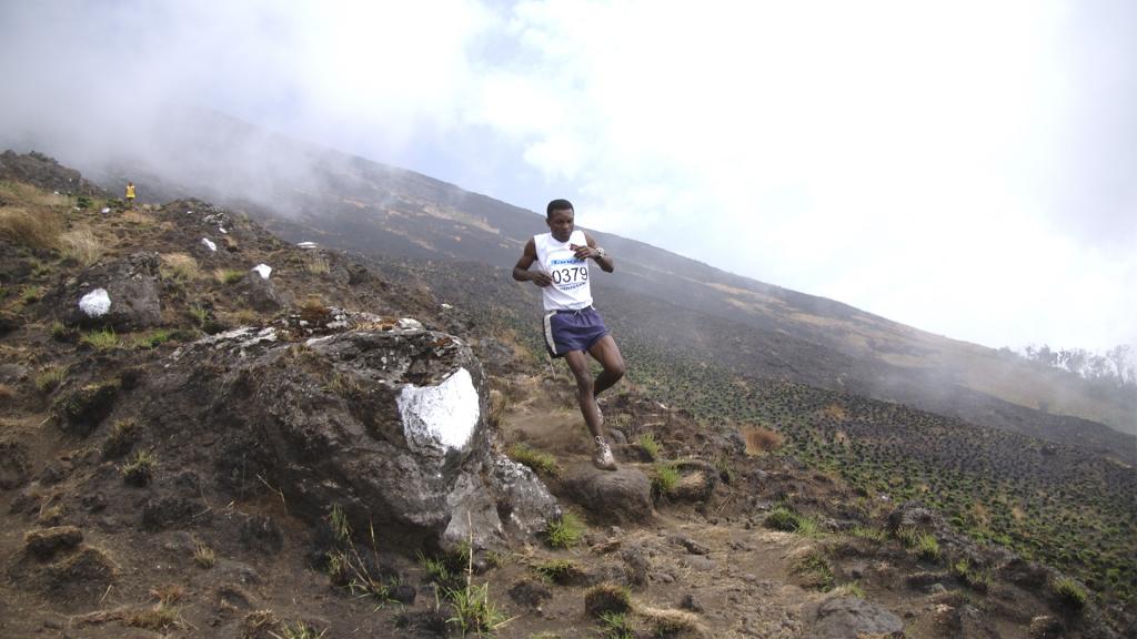 A marathon runner flies down Mt. Cameroon.